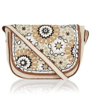Both whimsical (with its flower and star design) and functional (it fits phone, keys, wallet, and more), this bag can skew brunch casual or a little more dressy.