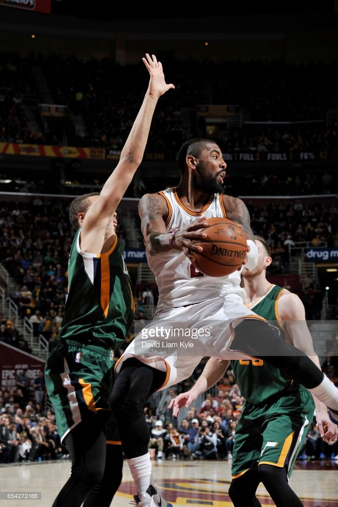 News Photo : Kyrie Irving of the Cleveland Cavaliers passes...