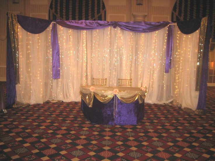 A regal purple anf gold backdrop for the bride and groom at the Chase Center on the Riverfront.