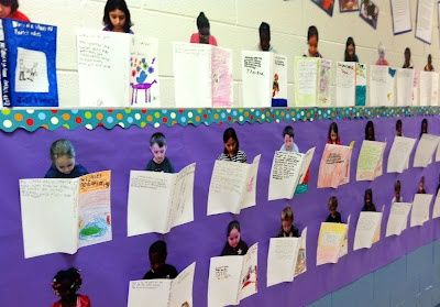 Take a picture of the kids as if they're reading – print out and cut out the outline of the child. Children design their own book covers which are stapled to their pictures to look 3D on a display – looks like the children are reading their books!