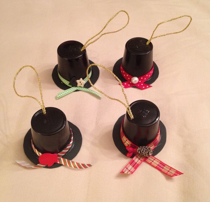 Snowmen top hats made from Keurig coffee cups.