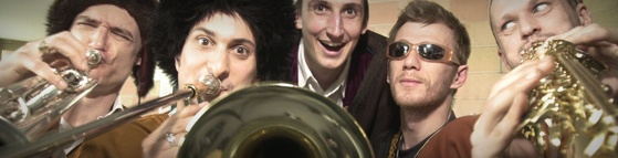 Blistering eastern brass harmonies and high-energy rhythms. Inspired by the Roma wedding and brass band music of the Balkans, fused by eclectic musical influences ranging from calypso and jazz to punk, The Baghdaddies are an experience not to be missed.