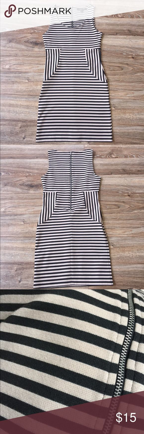 Black and Nude Mini Dress Fitted & stretchy, nude/black striped dress. Zipper down the back. The tag says a medium but runs small... fits more like a size Small or a 2/4 dress size. Like New! Forever 21 Dresses Mini