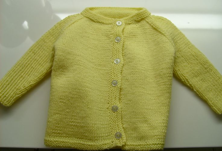 Knitted cardigan for a baby.