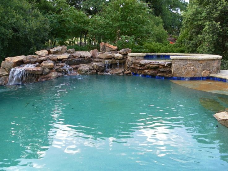 swimming pool Nice Swimming Pool Design With The Stone Edge Decoration And Small Waterfall At The Backyard How to Determine the Great Pool Builders