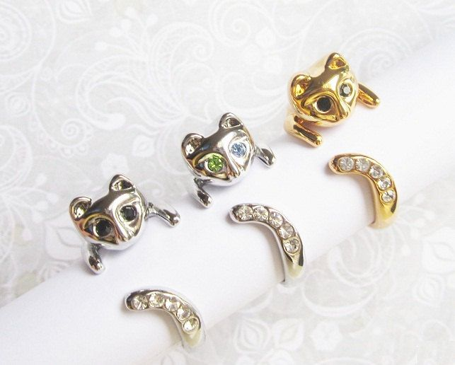 Sale -  3 Beautiful Cat rings with blue/green/black/white crystals.. $13.95, via Etsy.