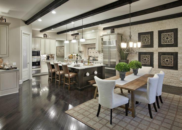 Beautiful Toll Brothers #kitchen design featuring Progress Lighting Cantata chandelier + Archie pendants. #inspiration #interiordesign