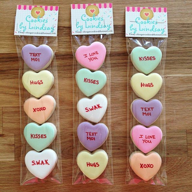 It wouldn't be Valentine's Day without some cute conversation hearts. #cookies #cookiesbylindsay #decoratedcookies #cookiedecorating #sugarcookies #royalicing #royalicingcookies #valentinescookies #love #yummy #conversationhearts #atamc2017 #valentinesdaycookies