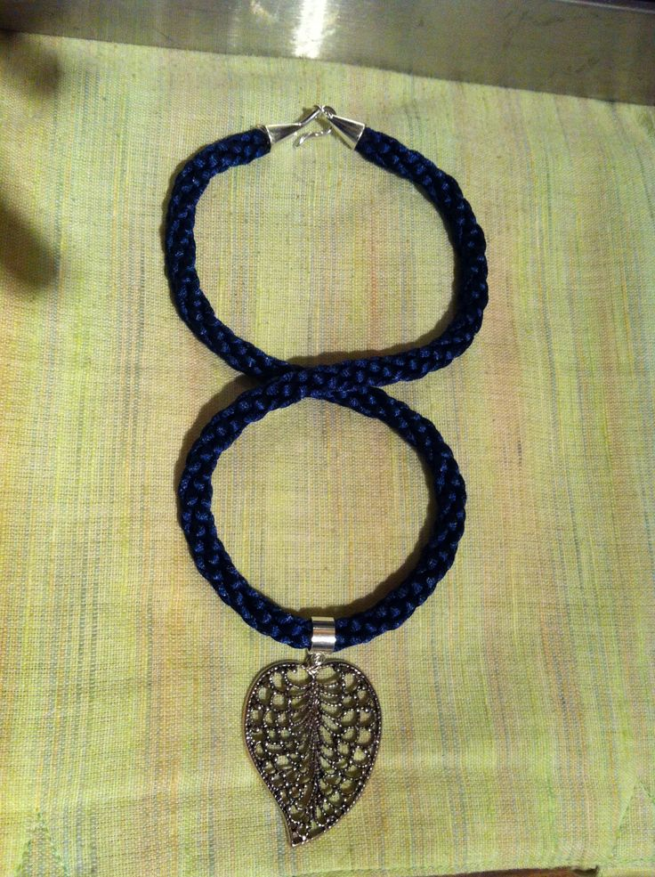 Blue kumihimo with large leaf pendant