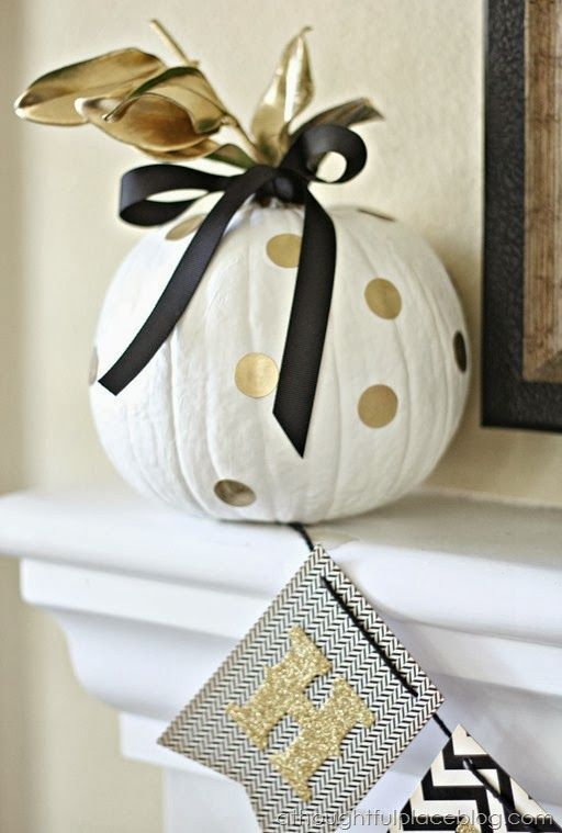 Swap the traditional Halloween orange + black combo for a more modern twist: gold + black.: