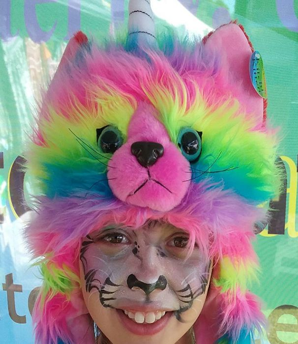 Fun with rainbow kitten hat. Bring it everywhere and enjoy color rainbow.