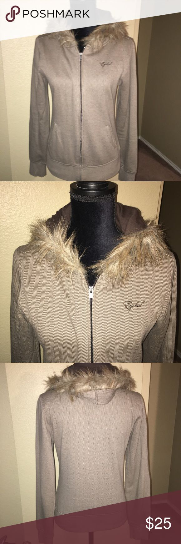 NWOT Ezekiel Girl Zip Faux Fur Trim Hoodie Jacket Pictures captures ALL!! Never worn. Neutral Taupe/Brown colors with brown lining inside the hood and trimming of faux fur! Perfect for these cool days. Size Medium, Ezekiel Girl, minimal stretch but a tailored cut. Could fit a Small and Medium. Ezekiel Jackets & Coats