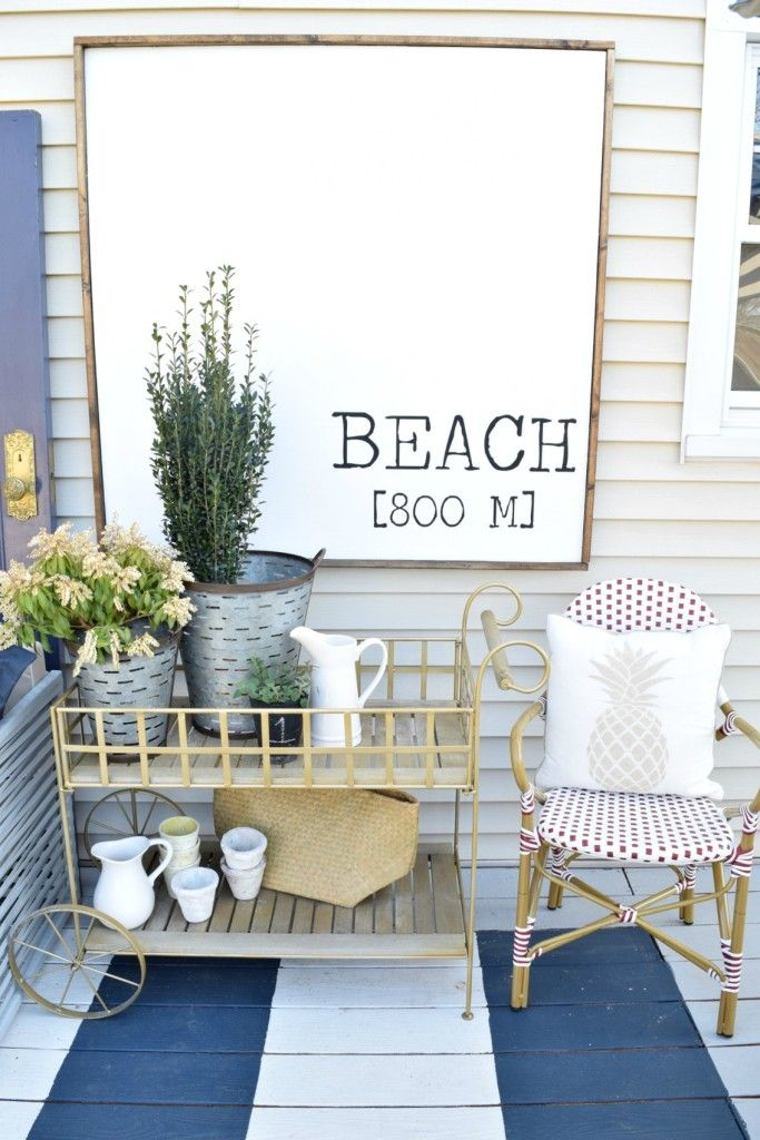Backyard Deck Remodel. Ideas for decorating your deck. Large beach sign and nautical touches - Nesting With Grace