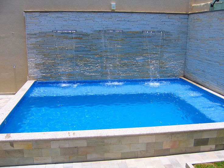 Could easily function as both a plunge pool or hot tub. Love the clean lines! Learn how you could do something similar at www.custombuiltspas.com