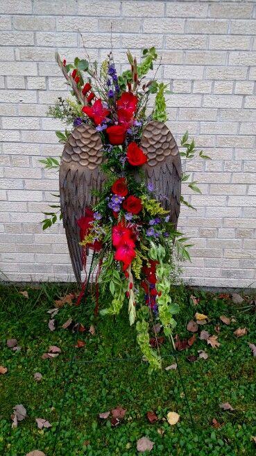 Sympathy easel with angel wings. By Trig's Floral Rhinelander WI.