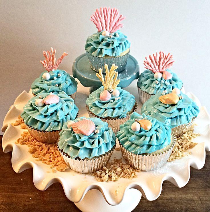 Beach theme cupcakes with fondant seashells,coral & starfish