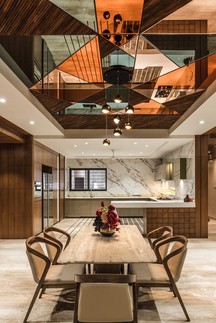 Beautiful Ceiling with mirror on dining area.