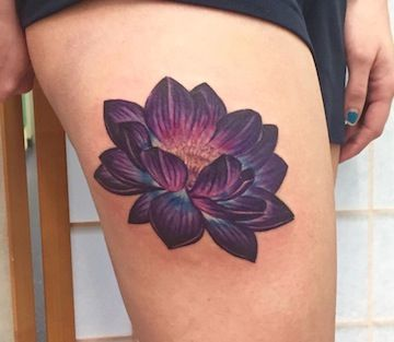 "purple lotus tattoo - On shoulder with ""Life is Beautiful"" coming off the side of it"