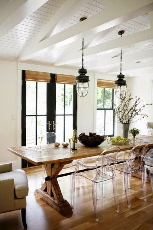 Modern Farmhouse Dining Room -- love the lights and the ghost chairs!