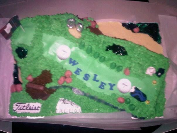 Wesley's Golf cake - St Andrew's cliffs in the back and his favourite things in the front