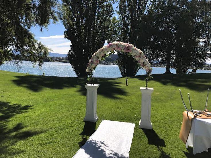 Archway of roses for a Wanaka wedding at Edgewater Lake Wanaka http://www.wanakaweddingflowers.co.nz