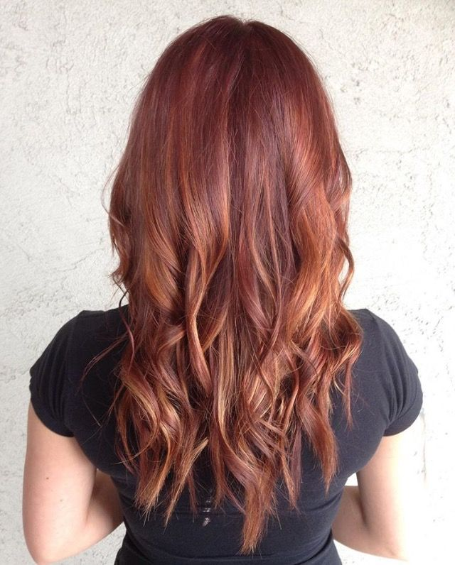 This stunning red ombre blends auburn, rose gold and blonde for a look that's classic, but still unique. Image by stylist Julie Nyman. Formula in comments.