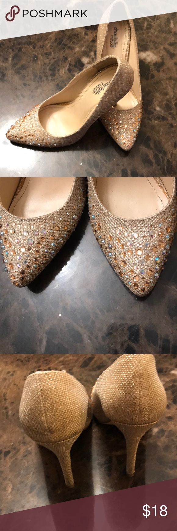 Sparkly Gold Heels Size 7 Charlotte Russe Sparkly Gold Heels Size 7. Only worn one time. Wore them with a black and gold dress for New Years! Would be really cute with a prom dress or Homecoming. Charlotte Russe Shoes Heels #promheelsgold #promheelssparkly