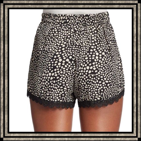 """Lace-Trimmed Shorts from Saks Off 5th These shorts have a black Lacey trim with an elastic waistline. Comfortable enough to sleep in with your favorite sleep shirt or pair with a cute top to wear during the day. In-seam about 2.5"""". Rayon. NWT. Saks Off 5th Shorts"""