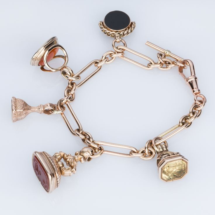 9k Rose Gold Fob charm bracelet with a mixture of seals and fobs - some antique some reproduction pieces. It's a real beauty. Available on 1st Dibs - The Jewellery Trading Company