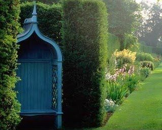 Painted Arbour With Seat In Hedge Alcove At Hazlebury Manor, Wiltshire, UK.  This Particular Blue Seems To Show Up In A Lot Of English Gardens.