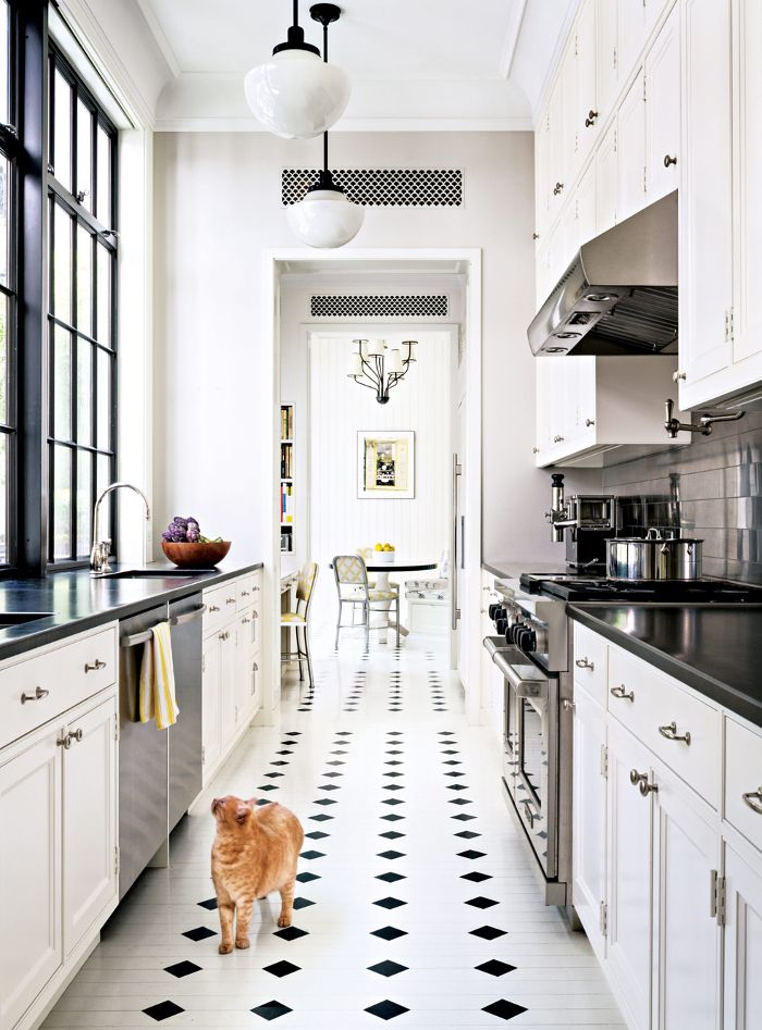 Black & white galley kitchen with beautiful visual flow