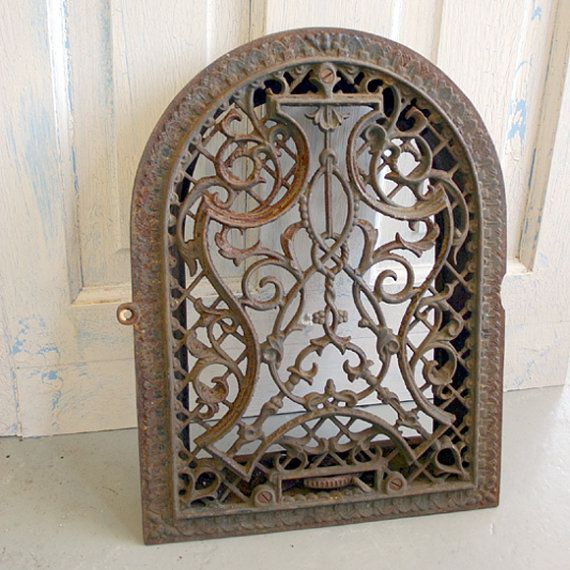 Antique Arched Heating Vent Grate    Ornate wall vent - or fab garden decor. Patina of rust, and a bite out of the side as shown in the pictures. There are no louvers.  Measures 14 5/8h x 11 3/4w x 2d.