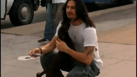 """GIF Brad Wilk and a dog he met on tour From Audioslave 's """"Your time has come"""" videoclip 2005"""