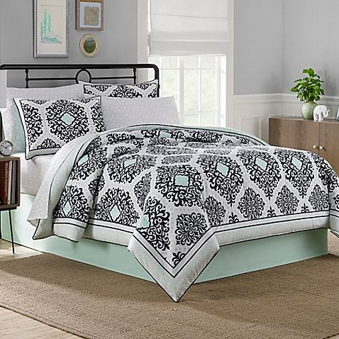 Bring a fashionable flair to your bedroom's décor with the sophisticated Cooper Reversible Comforter Set. The reversible bedding features a framed damask medallion pattern in black and white with mint colored accents.