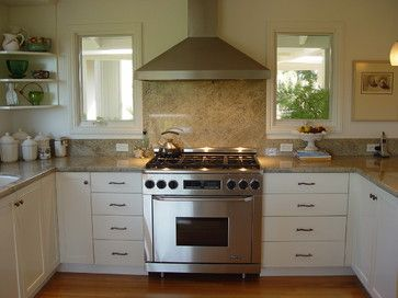 Consider installing White Springs granite backsplash behind range.  The butler's pantry could be made snazzy with a different application.   (traditional kitchen by Home Systems , Wendi Zampino)