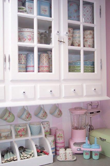 Cute white vintage/shabby kitchen! I like the counter utensil holder