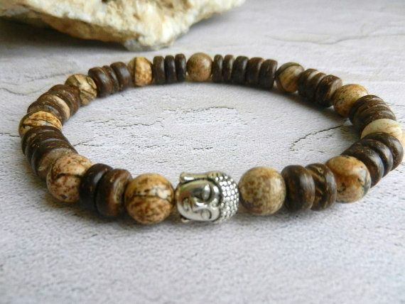 Bracelet is made of:  - Coconut beads - Picture Jasper beads ( 8mm) - Buddha bead - strong clear stretchy cord   Picture Jasper is a form of Brown Jasper. It is a grounding and harmonizing stone with a strong connection to the earth. It is said to promote feelings of responsibility towards the planet, encouraging a need to care for and protect it. All Jaspers are strong securing gemstones. It is a stability gemstone. It is a powerful protection against things that are not good for you and it…