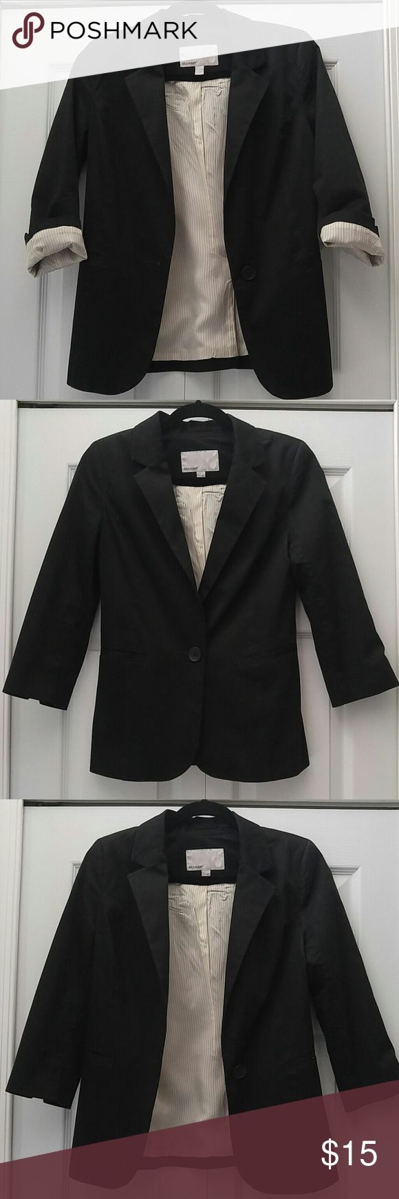 Old Navy Black Blazer Black blazer with 3 quarter length sleeves from Old Navy. Approximately 17 inches armpit to armpit. Approximately 24.5 inches from top of blazer to bottom. Shell: 98% cotton 2% spandex. Lining: 100% Acetate. Excellent condition, no holes, or stains. Buisness professional with slacks or a skirt or dress it down with denim! Old Navy Jackets & Coats Blazers