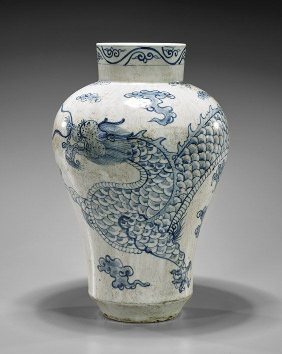 """Korean Blue & White Dragon porcelain vase; of baluster form with tall neck, depicting a sinuous dragon amid clouds, H: 14 1/2"""""""