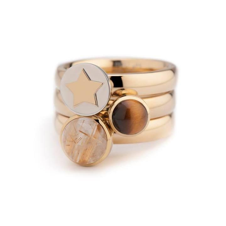 3 goud kleurige twisted ringen van melano met 3 verschillende steentjes