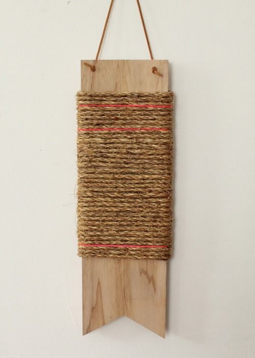Twine wrapped around a sturdy board = hanging cat scratcher for your doorknobs!