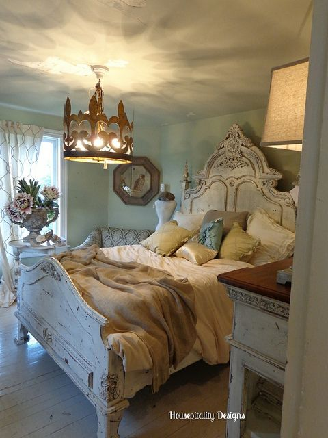 beautiful bedroom, head board and pillows. love the bedding.  The ceiling affect from chandelier.