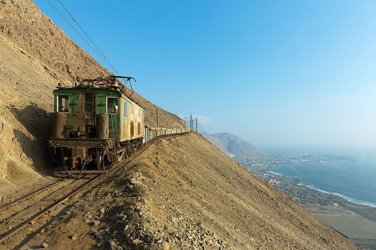 Operating on a narrow-gauge, the Maria Elena to Tocopilla railway transports more than 12 million tons of nitrates annually from several mines to the plant at Pedro de Valdivia. The vintage boxcab above, owned by Sociedad Química y Minera de Chile, is pictured with the port of Tocopilla in the background.