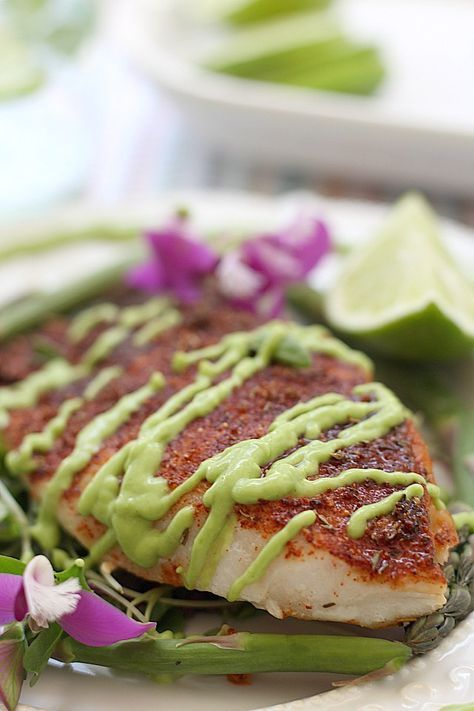 Tender white fish baked in the best blackened seasoning recipe and dressed in a delicious avocado fish taco sauce! This blackened rockfish recipe will rock your world! A seafood recipe perfectly paired over vegetables or in fish tacos.