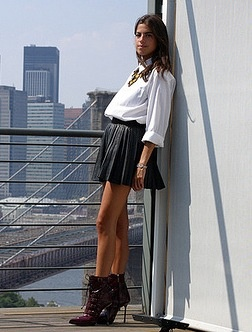 Black leather skirt, white blouse, ankle boots