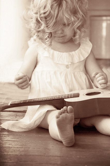 What a cutie pie. Start em young! Three chords on a ukelele can color a child's life in a big positive way.