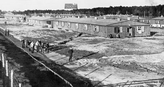 An overview of Stammlager Luft III - a permanent camp for airmen - showing  the distance between the huts and the perimeter wire. the tunnel...