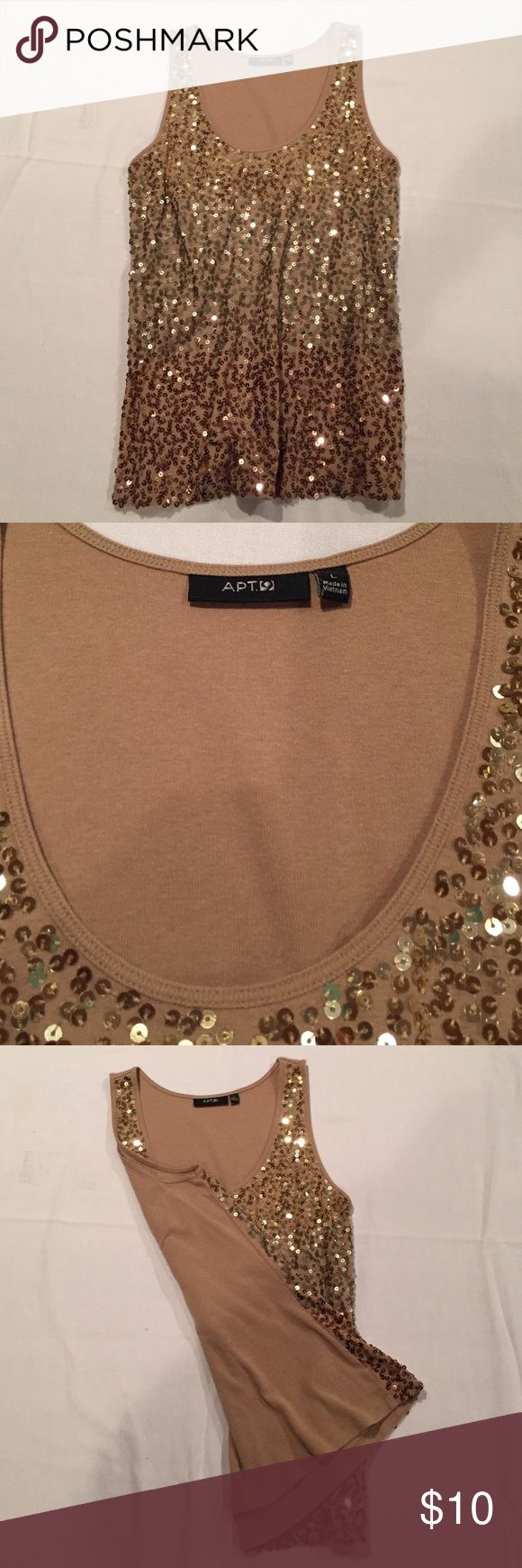 Gold Sequin Tank Top This gold sequined tank top is so comfortable with its cotton back. It is perfect with jeans or with a denim jacket. You will love it! The top is long enough to cover your belly and stretchy enough to fall nicely. Apt. 9 Tops Tank Tops