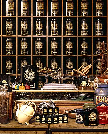 The wall of tea and counter scales like an old apothecary shop