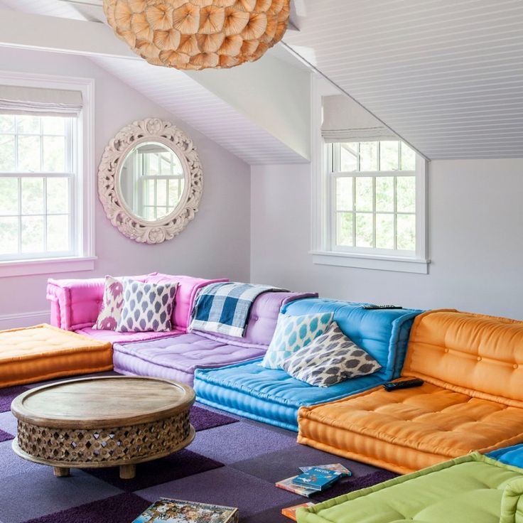 Bright living room with multicoloured modular sofa
